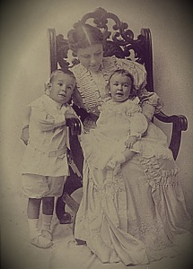 Marguerite Stewart Conant Withey sits with son Lewis Hinsdill, my Grandfather,  on her lap and son Thurber Conant standing. Photo date October 1905